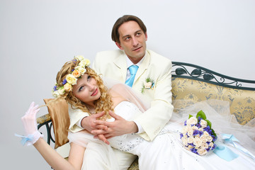 Young couple posing in a studio on the wedding day