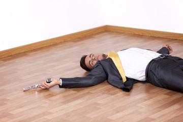 Dead businessman in the floor