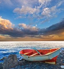 small boat on a sea coast