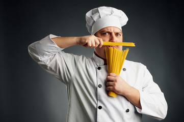 funny chef with spaghetti in his hands