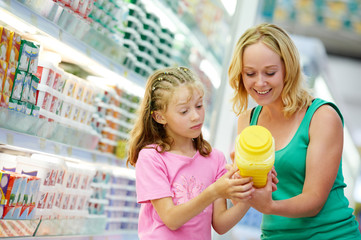 woman and girl making shopping