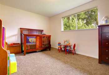 Simple baby room with wood crip