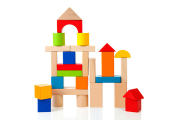House made out of colorful wooden building blocks