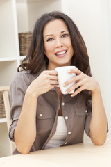 Woman At Home Drinking Tea or Coffee
