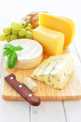 Assortment of cheese on a wooden platter