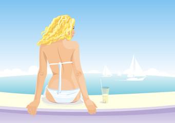 Beautiful girl sitting on a seaside