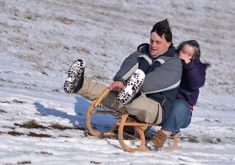 down syndrome couple sledding
