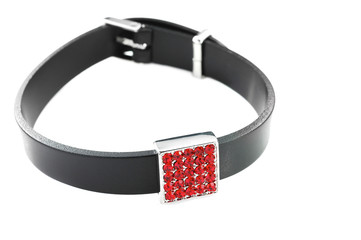 Wall Mural - Black rubber bracelet with red crystals isolated on white