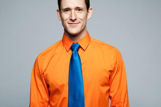 Happy handsome man in orange shirt.