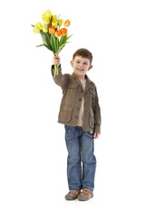 Cute little kid with bouquet of tulips smiling