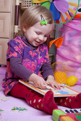 Baby girl collecting puzzle