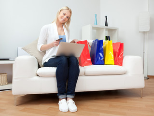 Beautiful woman shopping online