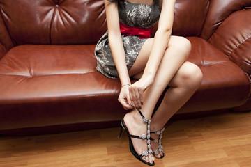 The woman dresses shoes