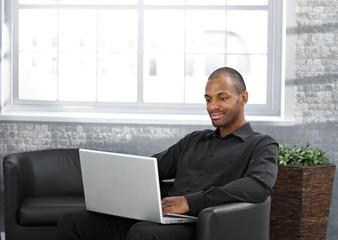 Businessman working in armchair