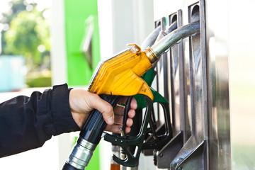 Man at gasoline pump