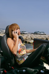 Woman in convertible car on the phone
