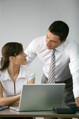Boss flirting with secretary