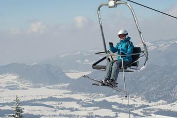 Young woman on ski elevator