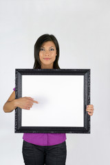 Woman with a blank picture frame