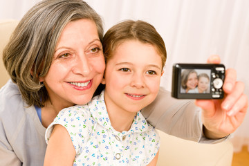 Grandmother and young girl take picture themselves