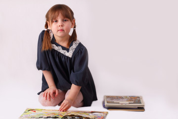 A little girl and books