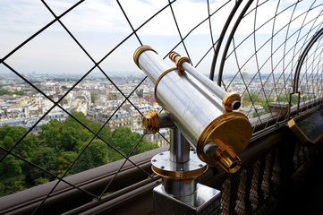 Telescope on top floor of Eiffel Tower in Paris