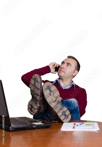 hombre descansando en la oficina stock photo and