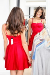 Woman trying red dress in store