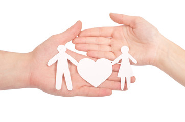 Paper family in hand with a big heart isolated on white