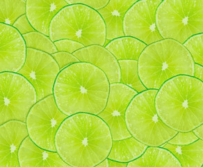 Obraz Lime slices background with a space for text - fototapety do salonu