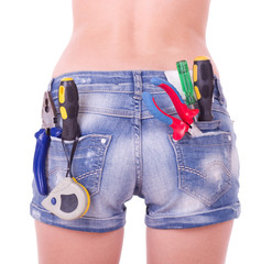 female worker with tools in back pocket on shorts