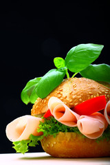 Delicious roll full of ham, paprika and lettuce