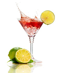 Fotobehang Opspattend water Red martini cocktail with splash and lime isolated