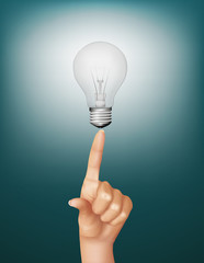 Finger touching brightly lit bulb. Concept of idea.