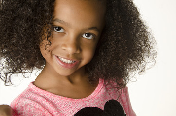 Adorable smiling little girl with curly hair