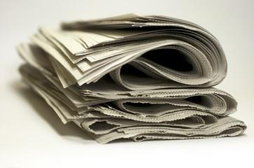Periódicos amontonados