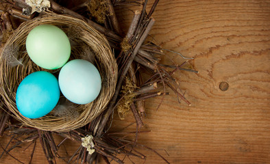 Easter Eggs in a Nest on a wooden background