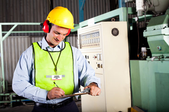 occupational health and safety officer inside factory