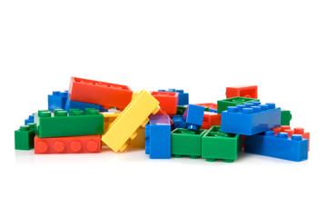 colorful plastic blocks over white background