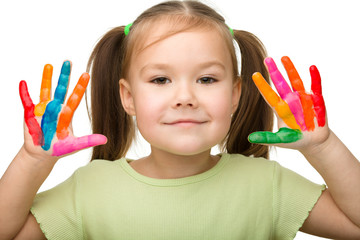 Cute cheerful girl with painted hands