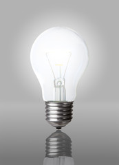 Classic Light bulb turned on isolated on gray with clipping path