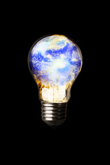 Earth in a Light Bulb on fire isolated on black
