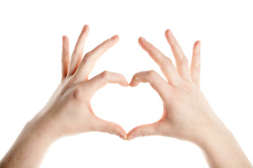 Female hands making heart sign