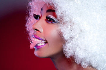 African Woman With Pierced Tongue And Wig