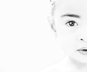 close-up portrait of a little girl. Black and white photo