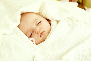 sleeping cute little baby. a large portrait of