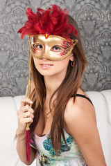 Attractive young lady with a mask