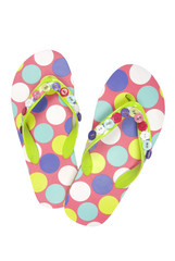 Pair of spoted flip flops on white, clipping path included