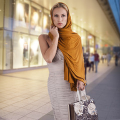 elegant fashion lady with shopping bag