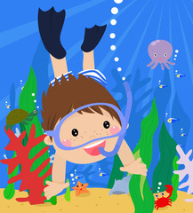 boy diving in the sea with mask and snorkel